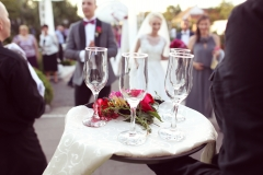 Waiter with four glasses of champagne